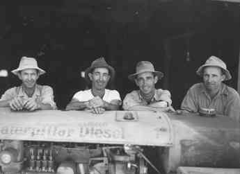 The second generation of the Allan Brothers family business as a fruit packing company: Walt, John, Alex, and Bob.  Photograph taken in 1940.
