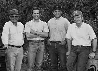 The third generation of the Allan Brothers fruit packing company: Dave, Todd, George, and Larry.  Photograph taken in 1992.