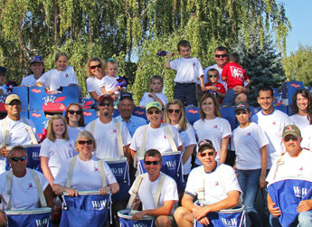 A group of Allan Brothers employees on the job at the Sportsman Day Parade in Naches, WA
