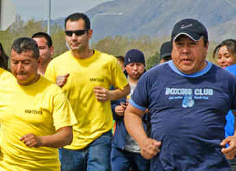 Employees participate in an Allan Brothers 5K dash outside of Naches, WA.