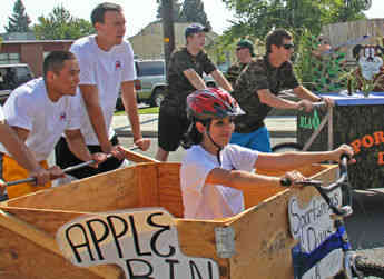 Allan Brothers employees line up at the starting line for the Apple Bin Races at the Naches Sportsman's Day Parade.
