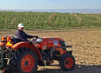 One of Allan Brothers' Washington fruit growers pauses for the camera while planting a honeycrisp apple orchard.